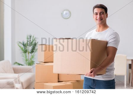 Man delivering heavy boxes at home