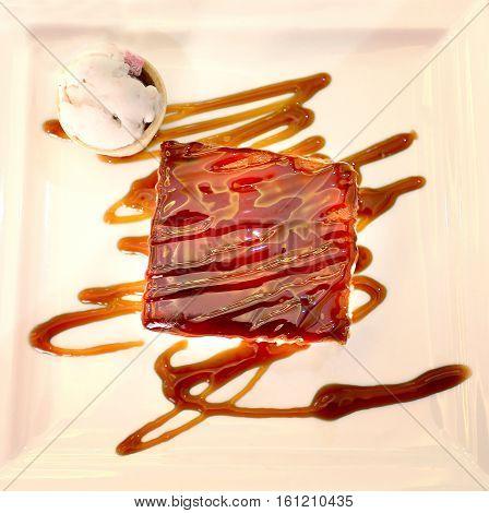 Photo of delicious chocolate caramel cake and ice cream
