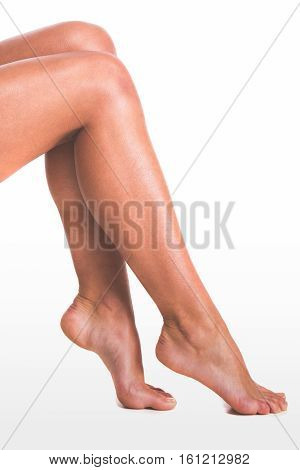 Body care of female smooth legs on white background