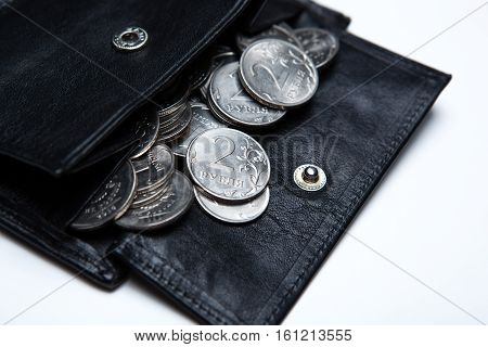 pocket purse with ruble coins on a white surface close up