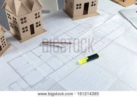 House plan blueprint and model house concept for new house design or home improvement.