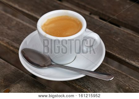 Espresso Coffee In White Cup Close Up On Table
