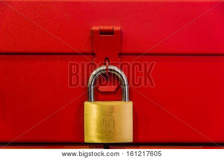 yellow lock hanging on red box background