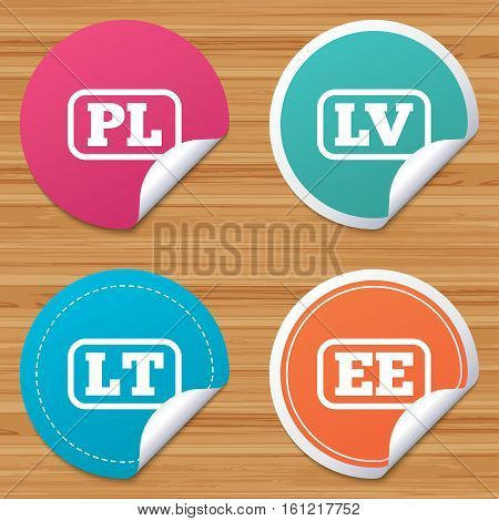 Round stickers or website banners. Language icons. PL, LV, LT and EE translation symbols. Poland, Latvia, Lithuania and Estonia languages. Circle badges with bended corner. Vector