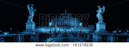 Castel Sant Angelo in Italy Rome at night panorama with statue of angel
