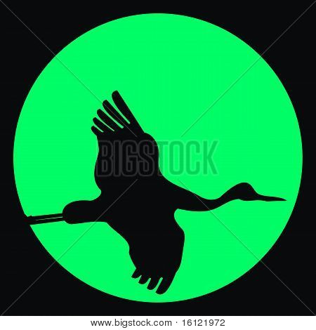 Vector silhouette of flying crane against moon on black sky poster