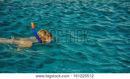 girl swimming in mask in sea tropical location