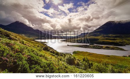 Scenic view of the lake and mountains Inverpolly Highlands of Scotland United Kingdom