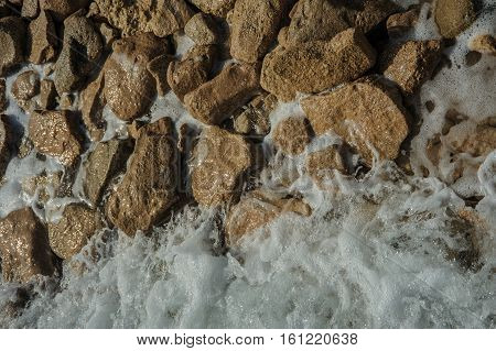 stones in red sea egypt background view water