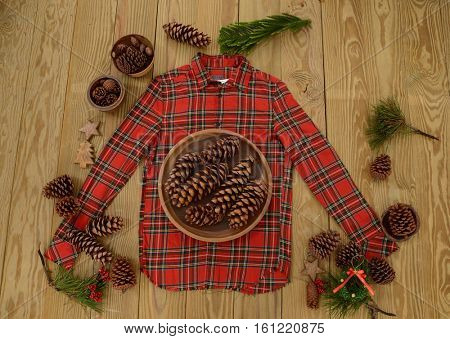 Fir Cones in bowl with clothes, Christmas decoration on Red picnic texture