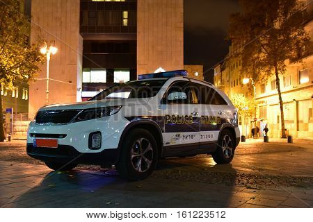 JERUSALEM ISRAEL10 12 16: The Israel Police is the civilian police force of Israel its duties include crime fighting traffic control maintaining public safety and counter-terrorism. Israeli police car in the city center in the evening.