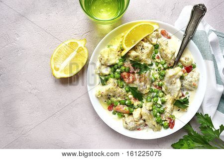 Codfish In A Cream Sauce With Vegetables.top View.