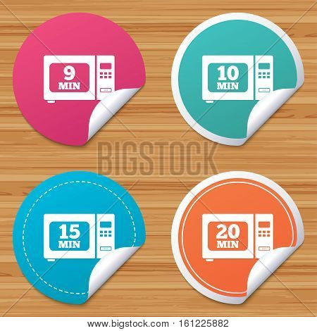 Round stickers or website banners. Microwave oven icons. Cook in electric stove symbols. Heat 9, 10, 15 and 20 minutes signs. Circle badges with bended corner. Vector
