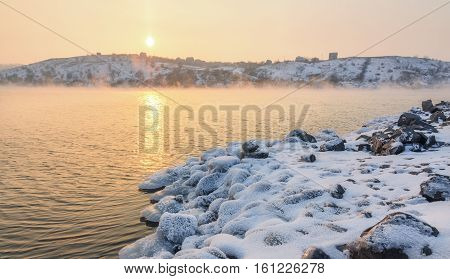 Winter Landscape With Snowy Stones At The Beautiful River