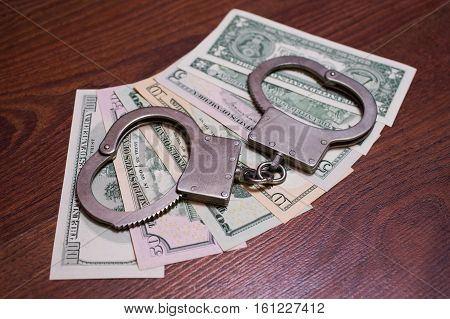 one two five ten twenty fifty and one hundred dollar bills back side and handcuffs