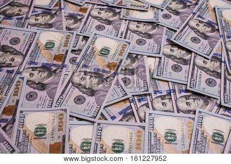 background of the money hundred dollar bills front side. background of dollars new hundred-dollar bill the evolution of the bill in one hundred dollars