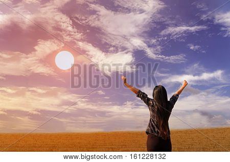 Women Stand And Raising Two Arm To Sky Freely At Hill Top