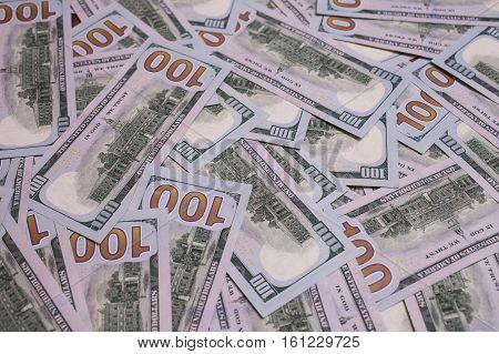 background of the money hundred dollar bills down back reverse side. background of dollars new hundred-dollar bill the evolution of the bill in one hundred dollars