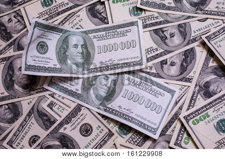 bill of one million dollars a new brilliant idea a million dollars the thirst for wealth success get rich millionaire background of the money hundred dollar bills front side. background of dollars old hundred-dollar bill face