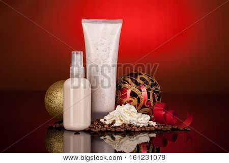 Bottle with cosmetic cream New Year balls and coffee beans on a glass background