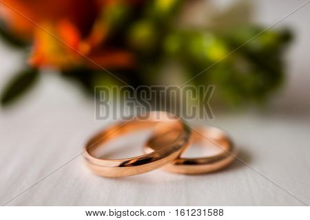 Wedding rings on a white background infinity sign of the rings