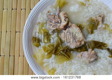 boiled rice in pickled Chinese cabbage and pork bone soup on bowl