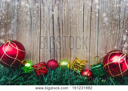christmas gift boxes and balls background on wooden texture