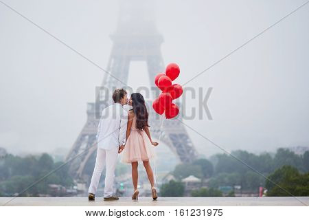 Beautiful Romantic Couple Near The Eiffel Tower In Paris