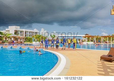 Cayo Guillermo island, Iberostar Playa Pilar hotel, Cuba, June 28, 2016, nice beautiful inviting view of comfortable cozy swimming pool with entertainment team and swimmers in background