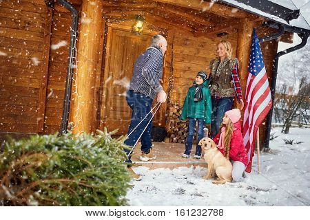 happy family with child with Christmas tree