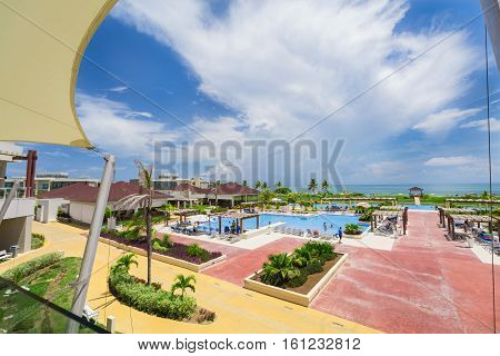 Cayo Coco island, Pullman hotel, Cuba, June 28, 2016, nice beautiful inviting view of big wide open comfortable swimming pool against ocean and blue sky background