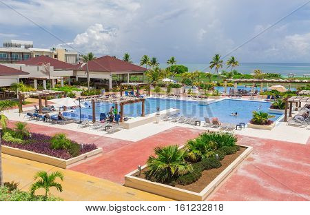 Cayo Guillermo island, Iberostar Playa Pilar hotel, Cuba, June 28, 2016, nice beautiful inviting view of big, wide open comfortable swimming pool with people relaxing and enjoying their time