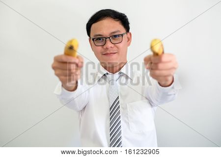 portrait of young ceo businessman  uses a banana instead of a gun.