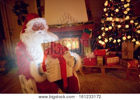Santa Claus with magical gift for you on Christmas