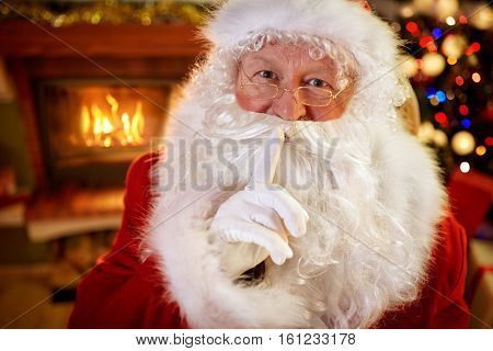 Santa showing to be silent gesture-keep my secret