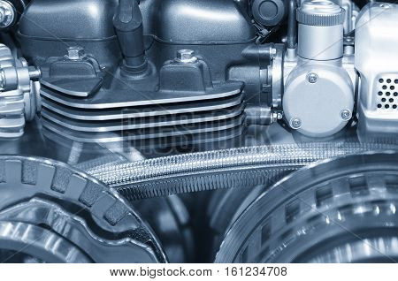 Abstract scene of the steel belt of motorcycle engine with the light-blue scene