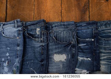 blue jeans on wooden.board