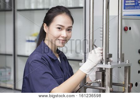 young woman engineer setup testing machine in laboratory