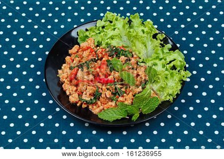 Fried Spicy Basil With Minced Pork Topped Lettuce.