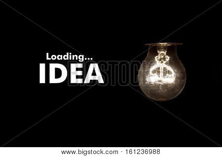 Bulb with message Loading IDEA on black background