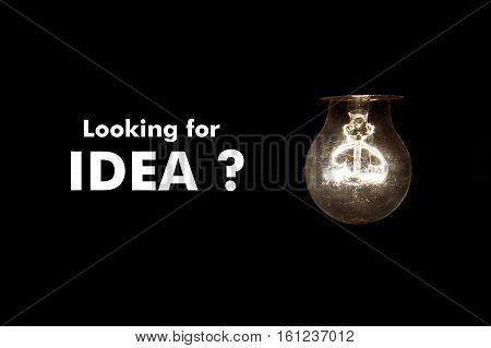 Bulb with message Looking for idea on black background
