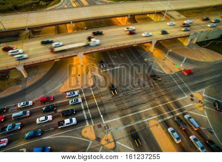 Aerial View looking down on Traffic Intersection Street light and Traffic on Mopac Expressway in Austin , Texas , USA during evening rush hour sunset
