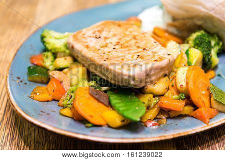 juicy steak veal - beef meat with tomato and vegetables