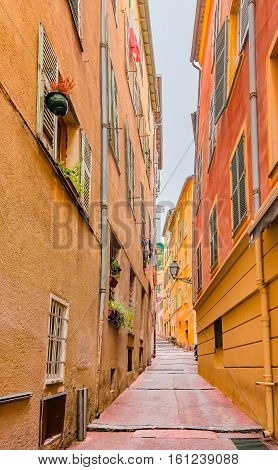 Narrow crooked street in the Old Town Vieille Ville in Nice French Riviera