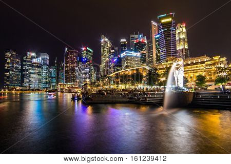 Singapore - June 24, 2016: Singapore skyline, Marina bay and Merlion fountain view at dusk