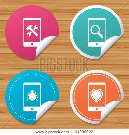 Round stickers or website banners. Smartphone icons. Shield protection, repair, software bug signs. Search in phone. Hammer with wrench service symbol. Circle badges with bended corner. Vector