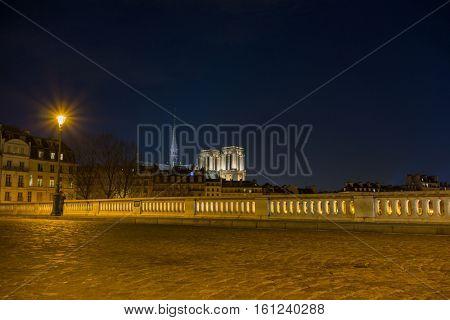 Bridge by the Seine river with view on Notre dame de Paris France