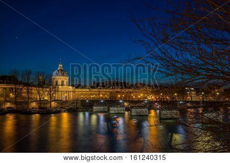 Pont des arts Bridge by the Seine river in Paris at night