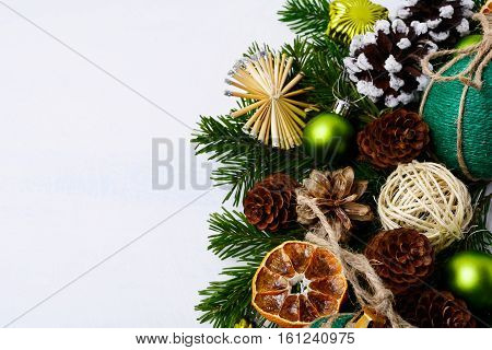 Christmas greeting background with handmade twine decorated bauble. Christmas background with fir branches and handmade rustic ornaments. Copy space.