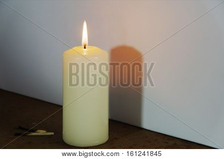 The Shadow Of A Burning Candle.